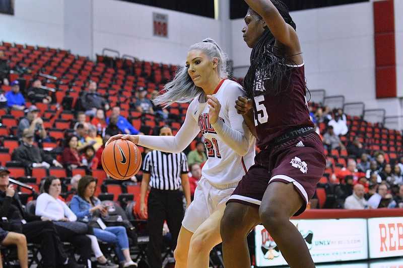 Dec 20, 2017; Las Vegas, NV, USA;  UNLV Rebels forward/center Katie Powell (21) drives against Mississippi State Bulldogs center Teaira McCowan (15) during the Duel In The Desert at the Cox Pavilion in Las Vegas, Nevada.  Photo by Sam Wasson for UNLV Athletics