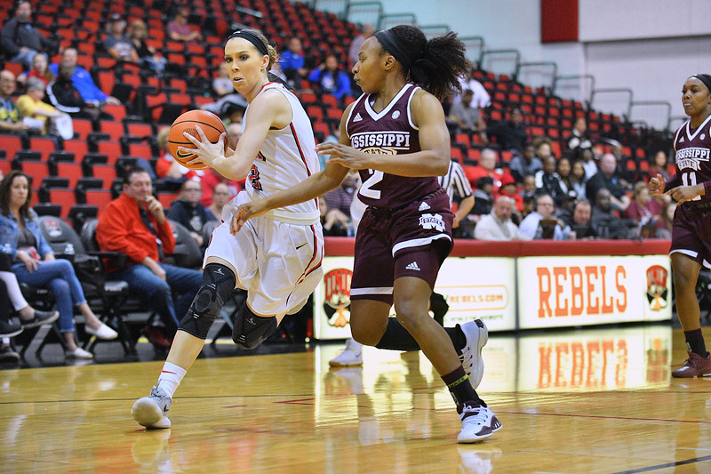 Dec 20, 2017; Las Vegas, NV, USA;  UNLV Rebels guard Brooke Johnson (2) drives against Mississippi State Bulldogs guard Morgan William (2) during the Duel In The Desert at the Cox Pavilion in Las Vegas, Nevada.  Photo by Sam Wasson for UNLV Athletics