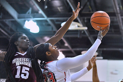 Dec 20, 2017; Las Vegas, NV, USA;  UNLV Rebels forward Jordyn Bell (23) drives in for a layup against Mississippi State Bulldogs center Teaira McCowan (15) during the Duel In The Desert at the Cox Pavilion in Las Vegas, Nevada.  Photo by Sam Wasson for UNLV Athletics