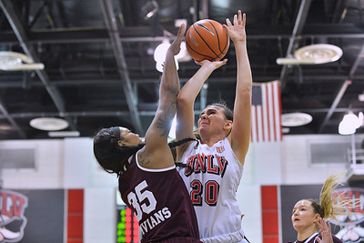 Dec 20, 2017; Las Vegas, NV, USA;  UNLV Rebels forward Alyssa Anderson (20) shoot against Mississippi State Bulldogs guard Victoria Vivians (35) during the Duel In The Desert at the Cox Pavilion in Las Vegas, Nevada.  Photo by Sam Wasson for UNLV Athletics