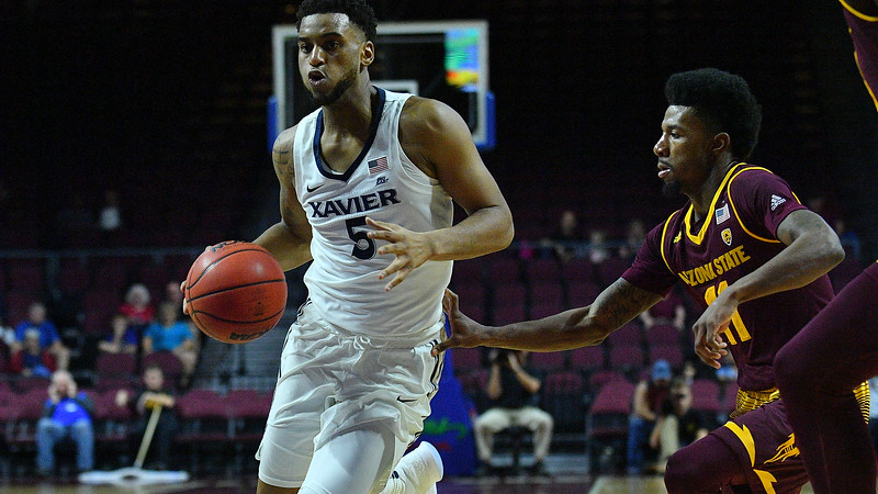 LAS VEGAS, NV - NOVEMBER 24:  Trevon Bluiett #5 of the Xavier Musketeers drives past Shannon Evans II #11 of the Arizona State Sun Devils during the championship game of the Las Vegas Invitational at the Orleans Arena on November 24, 2017 in Las Vegas, Nevada.  (Photo by Sam Wasson)