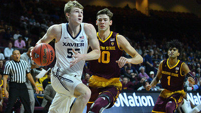 LAS VEGAS, NV - NOVEMBER 24:  J.P. Macura #55 of the Xavier Musketeers against Vitaliy Shibel #10 of the Arizona State Sun Devils during the championship game of the Las Vegas Invitational at the Orleans Arena on November 24, 2017 in Las Vegas, Nevada.  (Photo by Sam Wasson)
