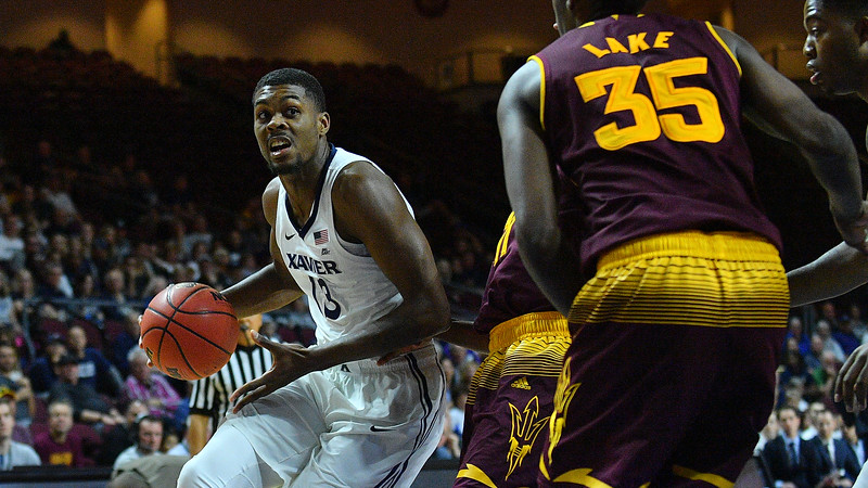LAS VEGAS, NV - NOVEMBER 24:  Naji Marshall #13 of the Xavier Musketeers drives against the Arizona State Sun Devils during the championship game of the Las Vegas Invitational at the Orleans Arena on November 24, 2017 in Las Vegas, Nevada.  (Photo by Sam Wasson)