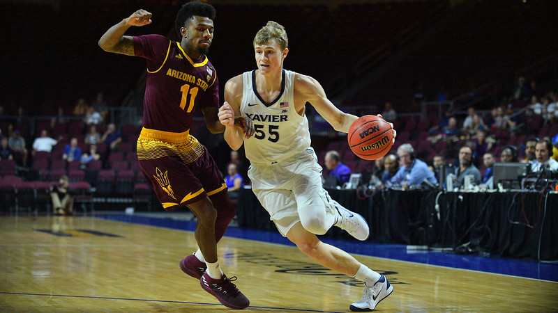 LAS VEGAS, NV - NOVEMBER 24:  J.P. Macura #55 of the Xavier Musketeers drives against Shannon Evans II #11 of the Arizona State Sun Devils during the championship game of the Las Vegas Invitational at the Orleans Arena on November 24, 2017 in Las Vegas, Nevada.  (Photo by Sam Wasson)