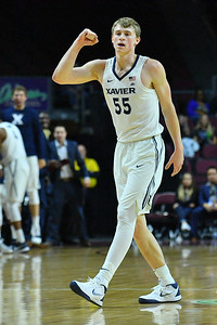 LAS VEGAS, NV - NOVEMBER 24:  J.P. Macura #55 of the Xavier Musketeers celebrates after a made basket against the Arizona State Sun Devils during the championship game of the Las Vegas Invitational at the Orleans Arena on November 24, 2017 in Las Vegas, Nevada.  (Photo by Sam Wasson)