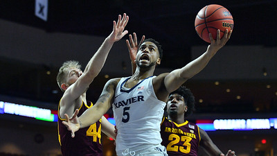 LAS VEGAS, NV - NOVEMBER 24:  Trevon Bluiett #5 of the Xavier Musketeers drives in for a layup against Kodi Justice #44 and Romello White #23 of the Arizona State Sun Devils during the championship game of the Las Vegas Invitational at the Orleans Arena on November 24, 2017 in Las Vegas, Nevada.  (Photo by Sam Wasson)