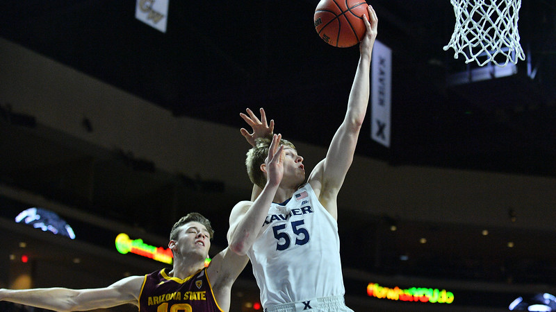 LAS VEGAS, NV - NOVEMBER 24:  J.P. Macura #55 of the Xavier Musketeers scores on a layup against Vitaliy Shibel #10 of the Arizona State Sun Devils during the championship game of the Las Vegas Invitational at the Orleans Arena on November 24, 2017 in Las Vegas, Nevada.  (Photo by Sam Wasson)