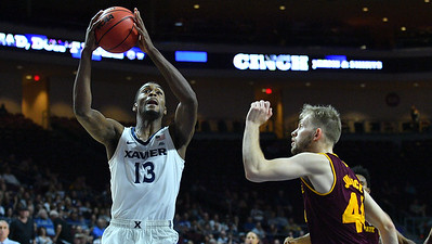 LAS VEGAS, NV - NOVEMBER 24:  Naji Marshall #13 of the Xavier Musketeers shoots against Kodi Justice #44 of the Arizona State Sun Devils during the championship game of the Las Vegas Invitational at the Orleans Arena on November 24, 2017 in Las Vegas, Nevada.  (Photo by Sam Wasson)