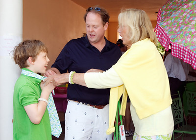 "Lilly Pulitzer showing Hunter Makk how to properly tie his ""Lilly"" tie"