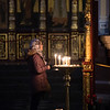 A worshipper inside the Zenkov Cathedral of PAnfilov Park in Almaty, Kazakhstan.