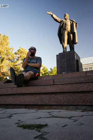 bishkek lenin statue and a blogger underneath