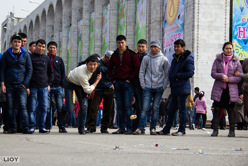 Playing national games on Bishkek's main ala-too Square during celebrations of the Nooruz persian new year holiday.