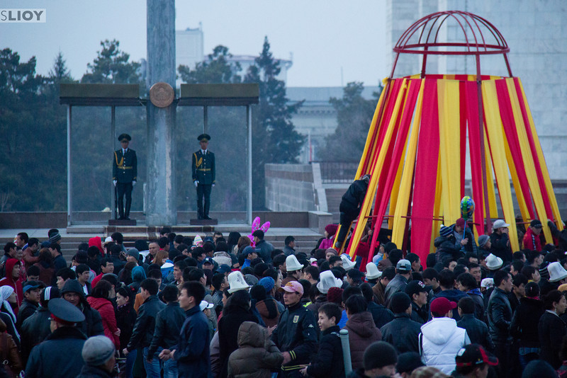 Symbolic soldiers guard the main Ala-Too Square in Bishkek Kyrgyzstan as Nooruz New Year celebrations go on all around.