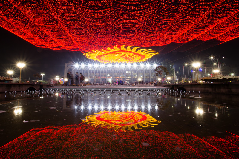 Bishkek's central Ala-Too Square illuminated at night.
