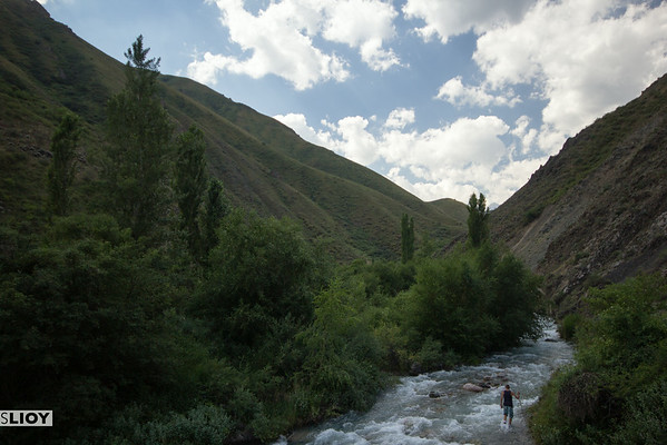 crossing a river in the tien shan mountains