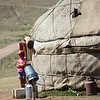 kyrgyz child standing with yurt