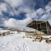 Snowy landscape and building at ZiL Ski Base in Kyrgyzstan.