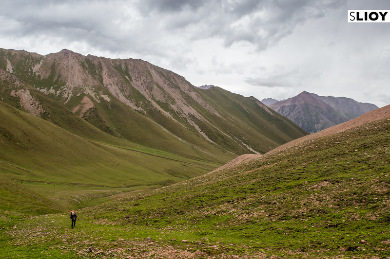 Hiking up the Tiorgei-Aksuu valley on the Boz-Uchuk Lakes trek from Jyrgalan village in Kyrgyzstan's Issyk-Kol region.