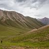 Hiking up the Tiorgei-Aksuu valley on the Boz-Uchuk Lakes trek from Jyrgalan village in Kyrgyzstan's Issyk-Kol region.