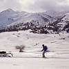 Free-Ride Skiiers Towed By A Snowmobile  in the Tian Shan Mountains near Jyrgalan Village in the Issyk-Kol region of Kyrgyzstan.