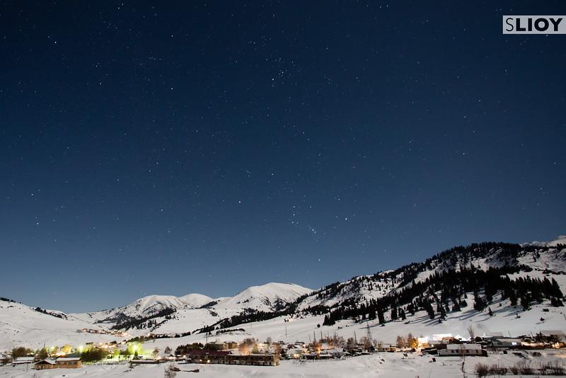 Tian Shan Winter Night Starscape Of Jyrgalan Village in the Issyk-Kol region of Kyrgyzstan.