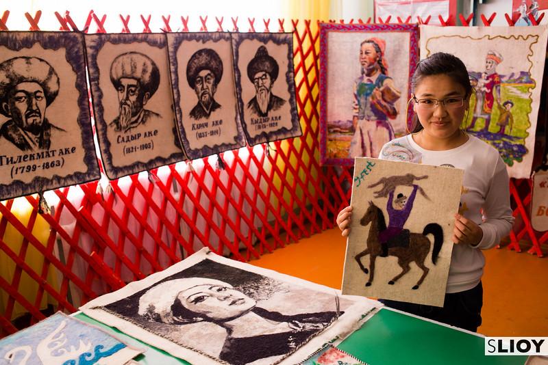 Young girl with feltwork handicrafts in Jyrgalan Kyrgyzstan
