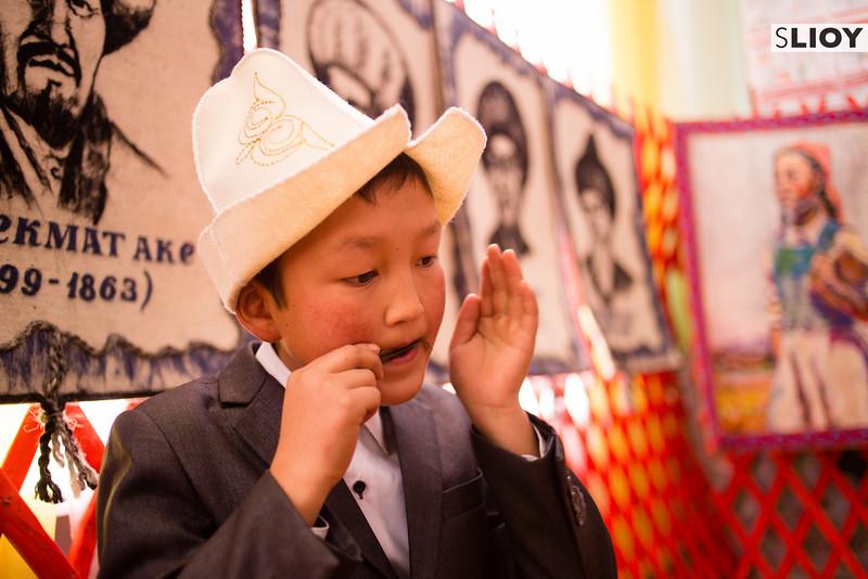 Young boy playing a mouth harp in Jyrgalan Kyrgyzstan