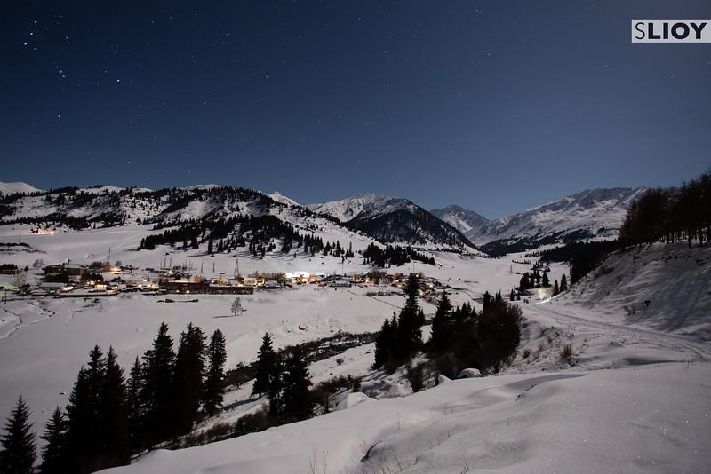 Bright Tian Shan Winter Night on the Road Out Of Jyrgalan Village in the Issyk-Kol region of Kyrgyzstan.