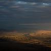 View of Bokonbaevo village at sunrise from the Shatyly Overlook in Kyrgyzstan's Issyk-Kol region.