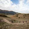 Hikers descending from the Shatyly Overlook in Kyrgyzstan's Issyk-Kol region.