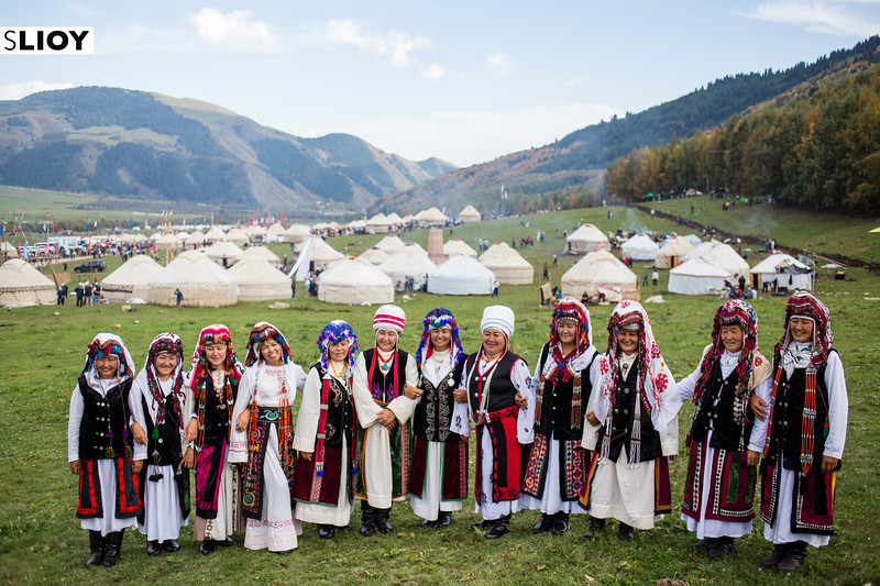 A female song and dance troupe pose in traditional costume at Jailoo Kyrchyn during the 2016 World Nomad Games in Kyrgyzstan.