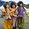 Three young children in traditional costume pose for portraits at Jailoo Kyrchyn during the 2016 World Nomad Games in Kyrgyzstan.
