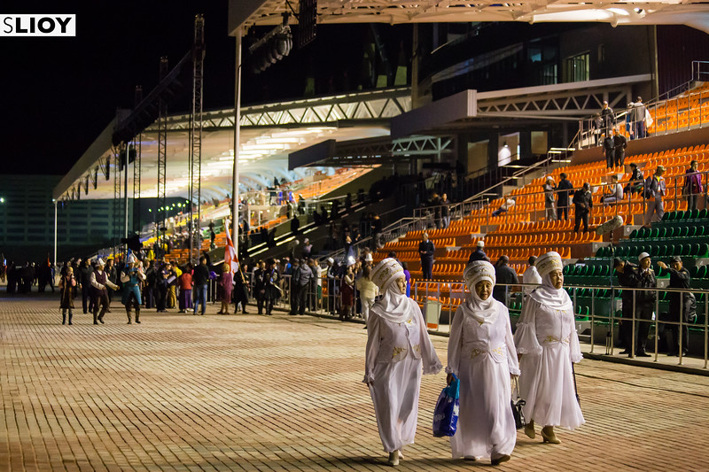 Kyrgyz women in traditional costume exit the stadium after the Opening Ceremony of World Nomad Games 2016 in Kyrgyzstan.j
