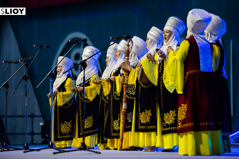 Kyrgyz ladies in traditional dress sing on-stage during a cultural performance at World Nomad Games 2016 in Kyrgyzstan.