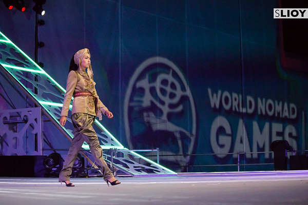 Kyrgyz model takes the stage to present local designer fashion during a cultural perforamnce at World Nomad Games 2016 in Kyrgyzstan.