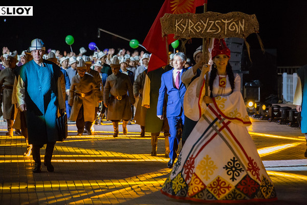 Kyrgyz president Almazbek Atambaev parades into the stadium with the Kyrgyzstan team during the Opening Ceremony of World Nomad Games 2016.