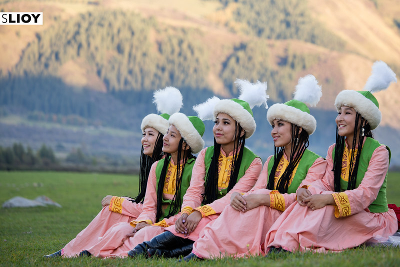 Kyrgyz girls from a local dance troupe pose for photos on Jailoo Kyrchyn at World Nomad Games 2016 in Kyrgyzstan.
