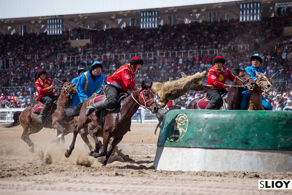 Kyrgyzstan's players launch towards the goal to score a point during the kok boru finals at the 2016 World Nomad Games at Issyk-Kol.
