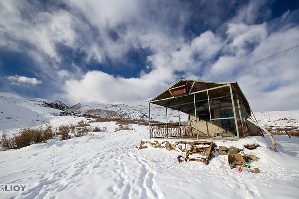 snowy abandoned hut in the mountains