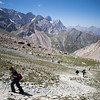 A group of trekkers climbs to the Shogun-Aga Pass from the Kulikalon Valley to Alauddin Valley in the Fann Mountains of Tajikistan.