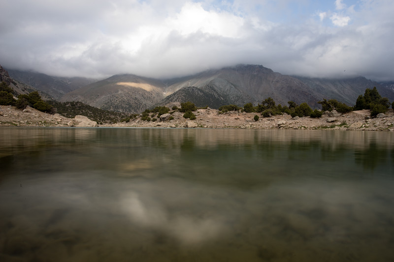 View over a small lake in the Kulikalon Valley of Tajikistan's Fann Mountains.