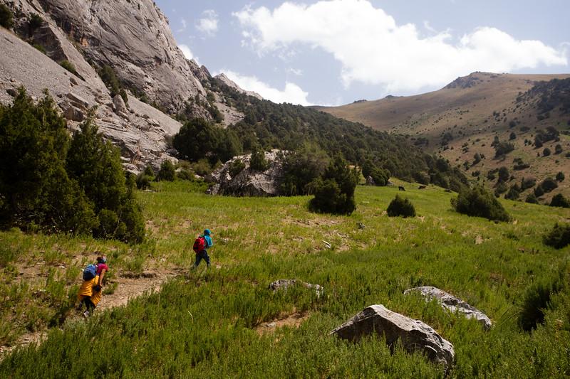 Trekkers hike out of the Chukurak Valley in the Fann Mountains of Tajikistan.