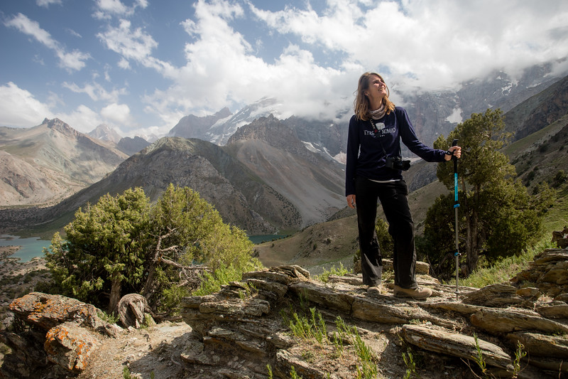 A foreign hiker stops to enjoy the view as she descends to the Kulikalon Lakes in the Fann Mountains of Tajikistan.