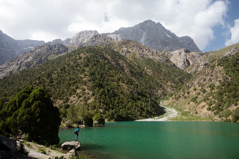 A local trekking guide stops to observe Chukurak Lake in the Fann Mountains of Tajikistan.