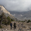Foreign hikers cross the Kulikalon Valley in the Fann Mountains of Tajikistan.