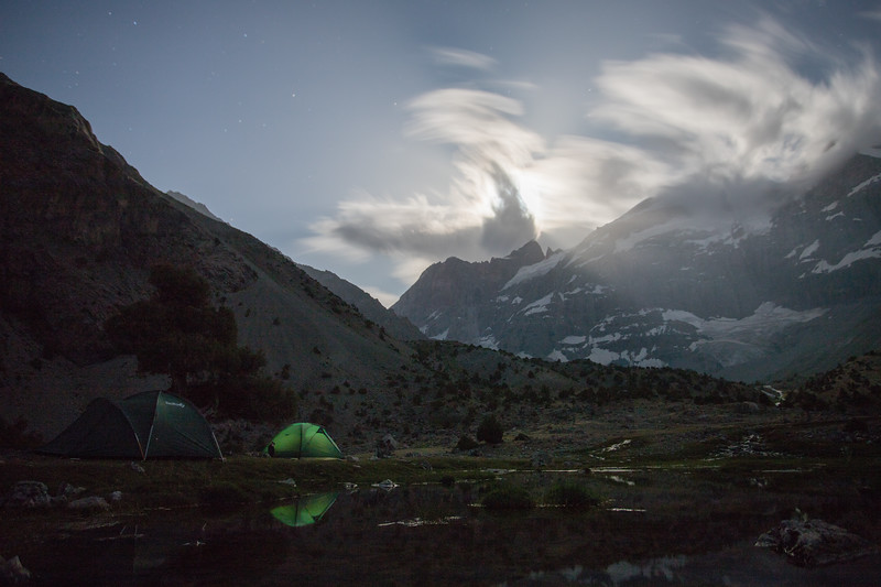 Camping on a bright moonlit night in the Kulikalon Valley of Tajikistan's Fann Mountains.