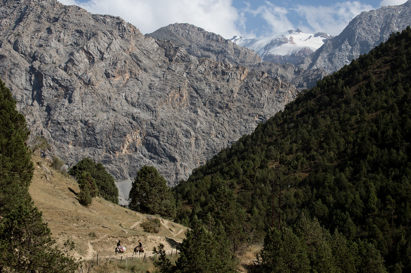 Local children ride donkeys up the Vrach Valley in Tajikistan's Fann Mountains.