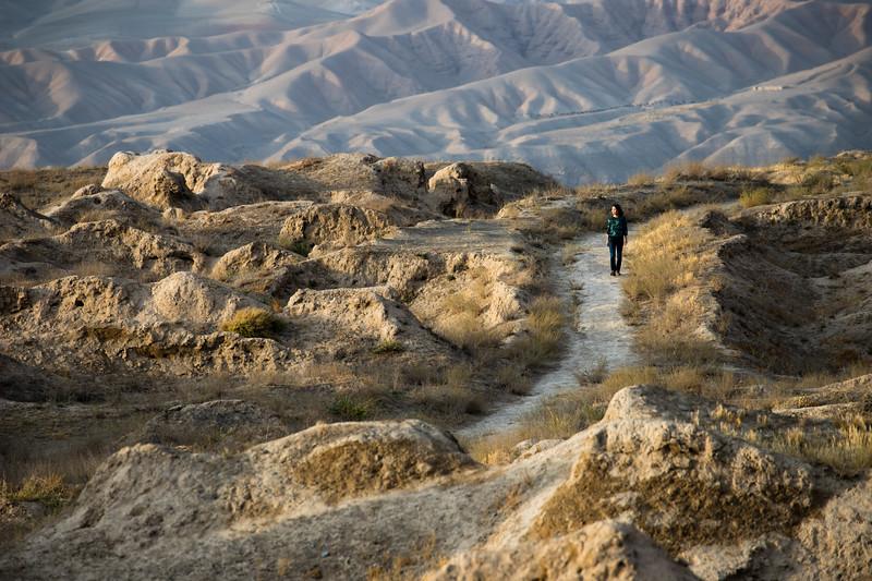 A tourist wanders the ruins of Old Penjikent in the Fann Mountains region of Tajikistan.