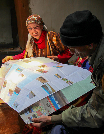 Reading the Pamirs map with a friendly family in Ratm village of the Tajik Wakhan.