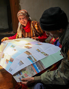 wakhan guides - looking over the map